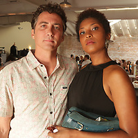 Scott Ball, left, and Martha Foye pose for a photo during Fashion On Front Thursday August 21, 2014 at Bakery 105 in Wilmington, N.C.(Jason A. Frizzelle)