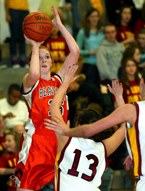 03/05/2010 -  Beaverton's Carley Losk (15) gets off a shot over the hands of Central Catholic's Amanda Craig (13). Central Catholic beat Beaverton 39-37.