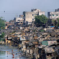 Slum shanty housing next to a polluted waterway in the North of the city.