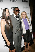 """l to r: Rustsk Bergman, Sean """" Diddy """" Combs and Franca Sozzani pictured at the cocktail party celebrating Sean """"Diddy"""" Combs appearance on the """" Black on Black """" cover of L'Uomo Vogue's October Music Issue"""
