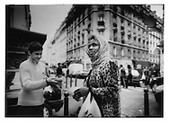14..West African Muslim woman transfixed while boy tries in vain to pay her, Chateau Rouge.