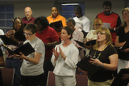 The Community Choir practices at First Baptist Church on Thursday, April 15, 2010.