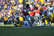 Ole Miss quarterback Bo Wallace (14) scores on a 58 yard run in the  first quarter vs. LSU safety Eric Reid (1) at Tiger Stadium in Baton Rouge, La. on Saturday, November 17, 2012....