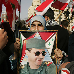 A protester holds a portrait of Syrian President Bashar al-Assad, Beirut, Lebanon, March 8, 2005. Hundreds of thousands of pro-Syrian protesters gather and chant anti-American slogans. Hezbollah, the militant Shiite Muslim group, called for a nationwide demonstration against foreign intervention and to counter weeks of massive anti-Syrian rallies.