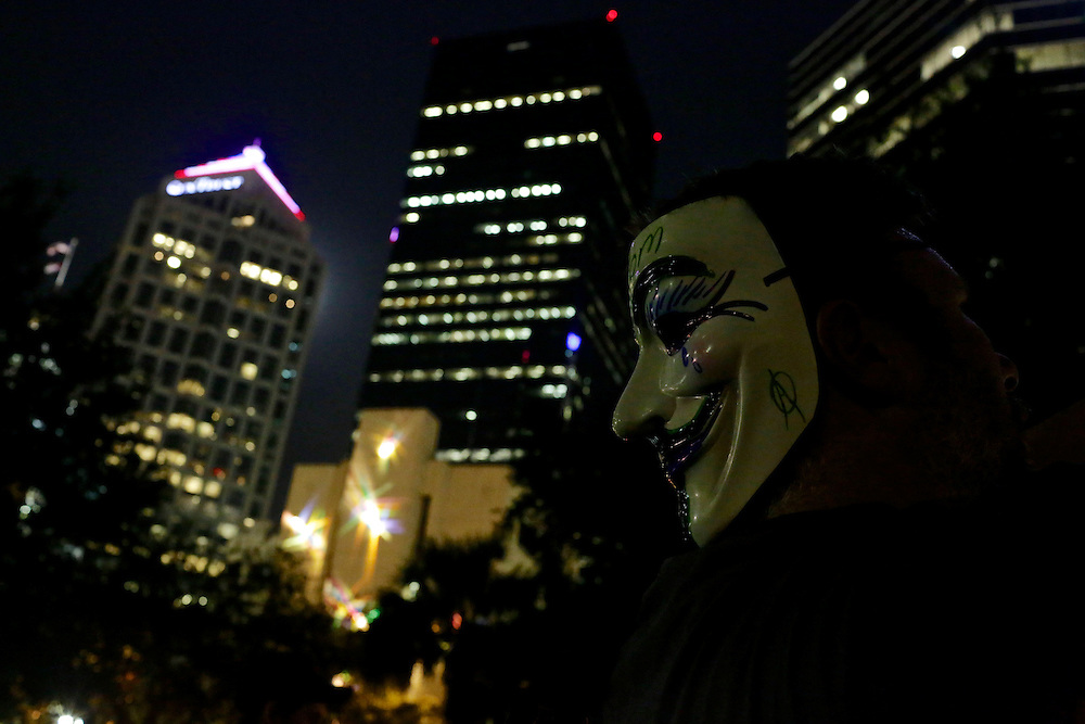 Protestors gather at Lykes Gaslight Square Park and remain silent in an unscheduled silent march against police brutality during the 2012 Republican National Convention in Tampa, Fla. on Aug. 29, 2012.