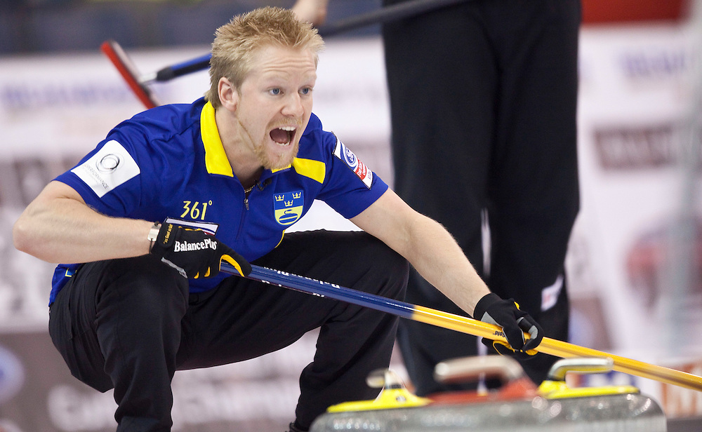 Swedish skip Niklas Edin screams instructions to the sweepers during Sweden's match against Switzerland at the World Curling Championships at the Brandt Centre in Regina, Saskatchewan, April 7, 2011.<br /> AFP PHOTO/Geoff Robins