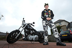 Karen Holmes with her Harley-Davidson motorcycle. Karen is a member of The Riders Branch, The Royal British Legion Scotland (RBL Scotland Riders or RBLS Riders). They attend all military ceremonies including funerals in Scotland..©Pic : Michael Schofield.
