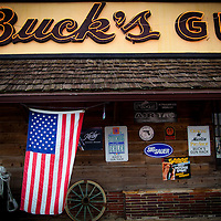 DAYTONA BEACH, FL -- An American flag hangs from the front at Buck's Gun Rack in Daytona Beach, Fla., on Friday, January 27, 2012. As the Florida Primary approaches, the voters along the I-4 corridor are becoming an increasingly more important path to securing a win.  (Chip Litherland for The New York Times)