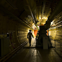 UK. London. British Telecom (BT) is selling some of its secret tunnels under the centre of London. The Kingsway Tunnels are 1 mile long and were originally built in 1940 as air raid shelters. They have been used by MI6 (Britain's secret service), the Public Records Office and BT..Photo shows Dave Hembra, a BT engineer responsible for the upkeep of the tunnel..Photo by Steve Forrest