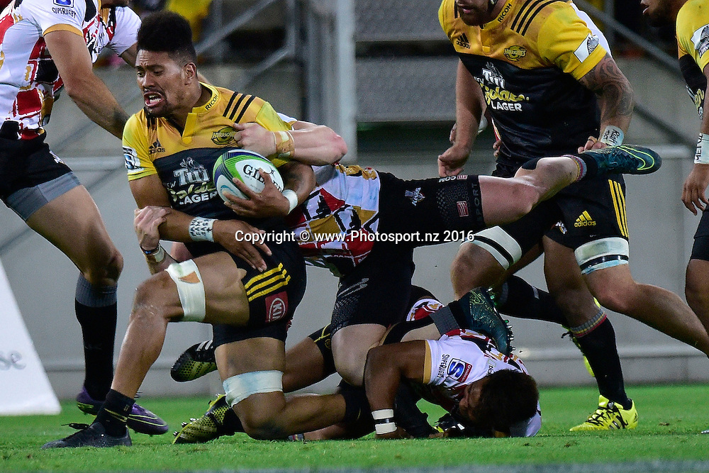 Ardie Savea of the Hurricanes is tackled by Chris Cloete of the Southern Kings during the Hurricanes vs Kings Super Rugby  match at the Westpac Stadium in Wellington on Friday the 25th of March 2016. Copyright Photo by Marty Melville / www.Photosport.nz
