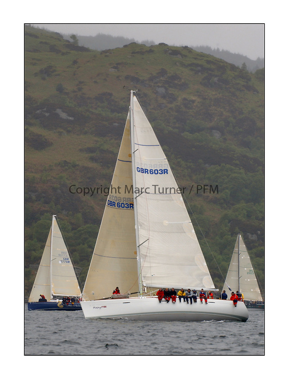 Yachting- The last days racing  of the Bell Lawrie Scottish series 2003 at Tarbert Loch Fyne.  Damp grey skies and light winds decided the final results in most fleets...Jonathan Anderson's Playing F$TE a First 47.7 in Class One....Pics Marc Turner / PFM