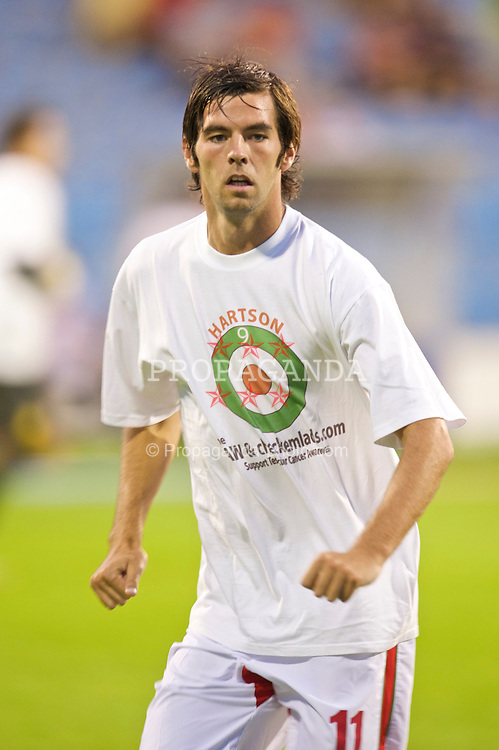 PODGORICA, MONTENEGRO - Wednesday, August 12, 2009: Wales' captain Joe Ledley warms-up wearing a shirt in support of former captain John Hartson who is battling against cancer, and to promote awareness of men's health issues with web site checkemlads.com, before an international friendly match against Montenegro at the Gradski Stadion. (Photo by David Rawcliffe/Propaganda)