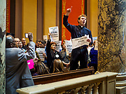 """04 MAY 2017 - ST. PAUL, MN: Pastor RORY PHILSTROM preaches in support of progressive causes in front of the Minnesota State Senate Chamber. About 200 people participated in a """"ISAIAH's 100 Days of Prophetic Resistance"""" rally at the Minnesota State Capitol in St. Paul. They represented churches from across the Twin Cities and were demonstrating in favor of paid sick leave, child care, and a higher minimum wage. The Twin Cities are more liberal than rural Minnesota and many Twin Cities municipalities have passed ordinances with paid sick leave, child care and higher minimum wages. Republican legislators from rural Minnesota have tried to pass laws in the legislature rolling back those ordinances.     PHOTO BY JACK KURTZ"""