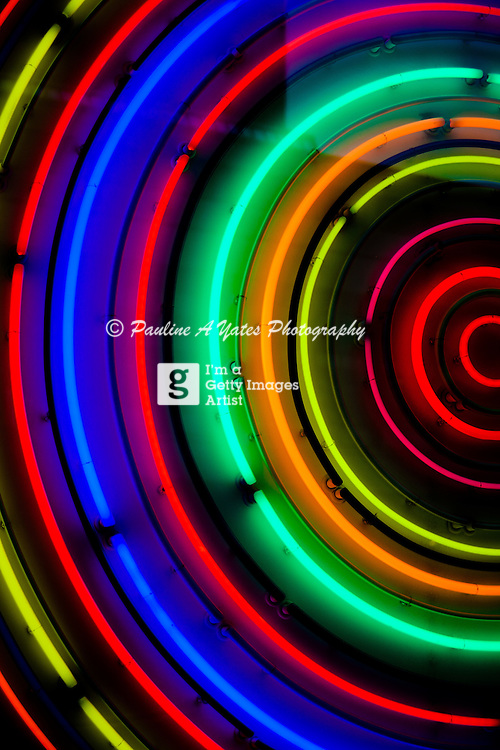 In the city of London, just near the museum of London is a circular neon rainbow light in a window.
