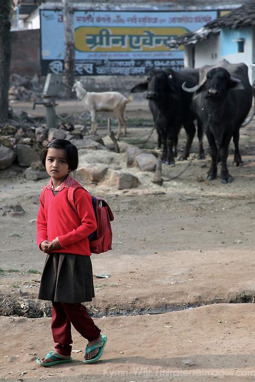 Asia, India, Khajuraho, A young girl heads to school in Khajuraho, India.