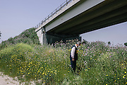 Members of the Environmental Guardians of Italy inspect a dump site full of plastics, asbestos and other toxic materials hidden under an overpass. Illegal sites like this are often burned to hide evidence, sending toxic smoke into neighboring towns. The region of Campania now has the highest infertility rate in Italy.