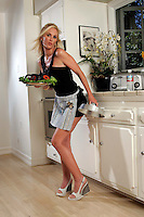 22 June 2005:  Brandy Blake, wife of Rob Blake Colorado Avalanche in the kitchen baking during The Not so Desperate, Desperate housewives shoot on location in Los Angeles with NHL hockey players wives for Editorial Use Only!  Mandatory Credit:  Shelly Castellano.com or Price Doubles. .