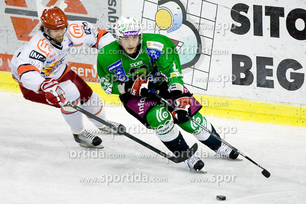 Andrej Hebar of Acroni Jesenice vs Damjan Dervaric of Tilia Olimpija at fourth Finals match of Slovenian ice hockey National Championships between HD Tilia Olimpija and HD Acroni Jesenice, on March 29, 2010, in Hala Tivoli, Ljubljana, Slovenia. Acroni Jesenice defeated Olimpija 3-2 and equalized score to 2:2.  (Photo by Vid Ponikvar / Sportida)
