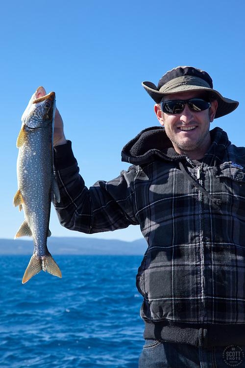 """Mackinaw Fishing on Lake Tahoe 2"" - This man, who caught a Mackinaw fish, was photographed near the West shore of Lake Tahoe, California."