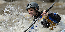 Joe Sartori of Chesterfield, Mo. practices on the slalom course prior to the start of the 45th Annual Missouri Whitewater Championships. Sartori later placed fourth in the K1 Men's Expert class and first in the K1 Men's Short Plastic (30 and up) class. The Missouri Whitewater Championships, held on the St. Francis River at the Millstream Gardens Conservation Area, is the oldest regional whitewater slalom race in the United States. Heavy rain in the days prior to the competition sent water levels on the St. Francis River to some of the highest heights that the race has ever been run. Only expert classes were run on the flood level race course.