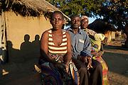 7 June 2010, Mbiya Camp, Mazabuka, Zambia. Lead Farmer, Harry Kandundu, with his two wives. On the left: Catherine Kandundu and on the right: Maggiret Kandundu.