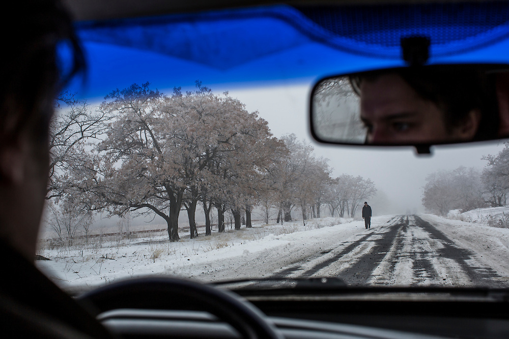 YURIVKA, UKRAINE - DECEMBER 8, 2014: A man walks along the road near Yurivka, Ukraine. CREDIT: Brendan Hoffman for The New York Times