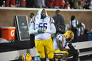 LSU's Trai Turner (56) looks around dejectedly as Mississippi celebrates a field goal with two seconds remaining at Vaught-Hemingway Stadium in Oxford, Miss. on Saturday, October 19, 2013. Mississippi won 27-24. (AP Photo/Oxford Eagle, Bruce Newman)