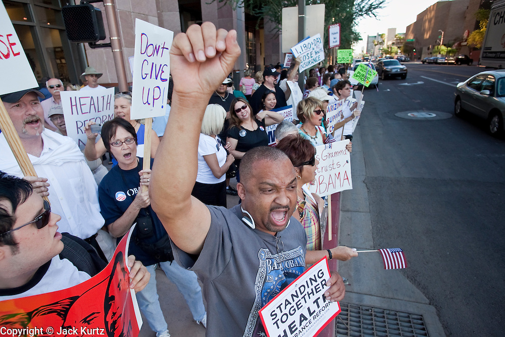 17 AUGUST 2009 -- PHOENIX, AZ: Lorenzo Kellam (CQ) from Phoenix, chants in support of President Obama and health care reform. About 5,000 people were expected to demonstrate in favor of President Obama's health care proposals. Nearly 1,500 showed up to demonstrate against the President.  PHOTO BY JACK KURTZ