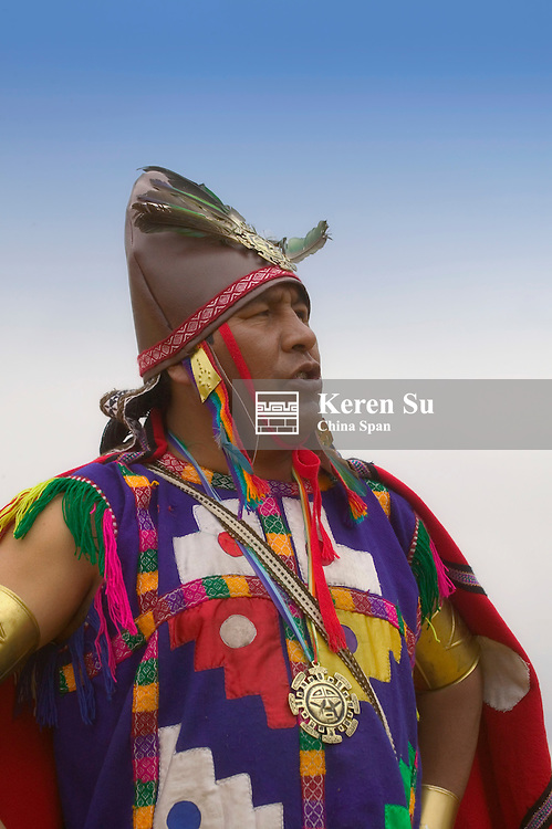 Portrait of Indian man dressed as warrior at Inti Raymi Festival celebrating winter solstice, Sacsayhuaman ruins, Cuzco, Peru