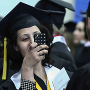 A Goldey-Beacom College Student takes pictures during Goldey-Beacom commencement exercise Friday, May 1, 2015, at Joseph West Jones College Center on the campus of Goldey-Beacom College in Wilmington Delaware.