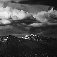 The Santa Catalina Mountains, commonly referred to as the Catalina Mountains or the Catalinas, are located north, and northeast of Tucson, Arizona, United States, on Tucson's north perimeter. The mountain range is the most prominent in the Tucson area, with the highest average elevation. The highest point in the Catalinas is Mount Lemmon at an elevation of 9,157 feet above sea level and receives 180 inches of snow annually.<br /> <br /> Originally known by the Tohono O'odham Nation as Babad Do'ag,[1] the Catalinas were later named by Italian Jesuit priest Eusebio Francisco Kino in honor of St. Catherine in 1697.[2]