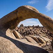 Mobius Arch, in BLM Alabama Hills Recreation Area, on the eastern side of the Sierra Nevada Mountains in the Owens Valley, west of Lone Pine in Inyo County, California, USA. The Alabama Hills are a popular filming location for television and movie productions (such as Gunga Din, Gladiator, Iron Man,  Transformers: Revenge of the Fallen), especially Westerns (Tom Mix films, Hopalong Cassidy films, The Gene Autry Show, The Lone Ranger, Bonanza, How the West Was Won, and Joe Kidd). Two main types of rock are exposed at Alabama Hills: 1) orange, drab weathered metamorphosed volcanic rock 150-200 million years old; and 2) 82- to 85-million-year-old biotite monzogranite which weathers to potato-shaped large boulders.