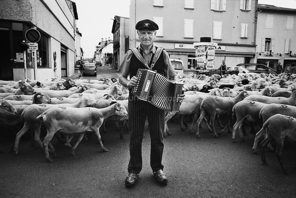 A local man plays accordion during the summer transhumances in the valley of Bethmale in the Pyrenees, France.