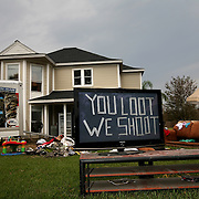Bobby Reynolds of San Antonio applied some humor when helping his friend Matt Agee salvage his belongings after Hurricane Ike in Bridge City, Texas, Thursday September 18, 2008.  The statement on the television, written in duct tape, is illuminated by the lamp at night with a generator.  Reynolds thought it would make neighbors smile.