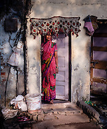 An Indian woman stands in her door step, in Mumbai, Maharashtra, India, on  January 26, 2015.<br /> Photo by Oren Nahshon