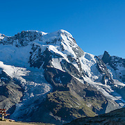 "From Rotenboden, from left to right are the peaks of: Monte Rosa massif / Dufourspitze (4634 m / 15,203 ft, second-highest mountain of the Alps and highest of Switzerland), Castor & Pollux, Breithorn (""broad horn"", 4164 m) and Matterhorn in the Pennine/Valais Alps, Europe. In Zermatt, the Gornergrat rack railway (GGB) takes you to a spectacular ridge (at 3135 m or 10,285 ft) between Gornergletscher and Findelgletscher. Gornergrat train, opened in 1898, climbs almost 1500 m or 4900 ft. Gornergrat train, opened in 1898, climbs almost 1500 m or 4900 ft via Riffelalp and Riffelberg. This image was stitched from multiple overlapping photos."