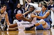 INDIANAPOLIS, IN - FEBRUARY 02: Roosevelt Jones #21 of the Butler Bulldogs and Jordan Hare #4 of the Rhode Island Rams battle for a loose ball at Hinkle Fieldhouse on February 2, 2013 in Indianapolis, Indiana. (Photo by Michael Hickey/Getty Images) *** Local Caption *** Roosevelt Jones; Jordan Hare