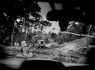 Chinese workers, for China Dalian International, stationed in Suriname for two years, are paving the road from Brokopondo to Atjoni deep within Saamaka Maroons territory in the Amazon rainforest of Suriname.  The deep interior is resource-rich with vast old growth rainforest and known reserves of gold.  Many Surinamese, particularly the Saamakas, are concerned that China has its eyes on the sparsely populated country's resources. and recently several memoranda of understanding have signed between Paramaribo and Beijing to clear the way for Chinese investment in resource exploitation.  On 2 December 2010, China and Suriname signed a memoranda of understand where Suriname would receive US$6 billion in projects to build a railroad and highway between the capital, Paramaribo and Manaus, Brazil following this route and carry on straight through Saamaka territory (this highway being part of the route).  The Saamaka were not included in negotiations.  This would have opened up one of the world's largest untouched rainforest wildernesses to rapid encroachment along the path of the railroad/road.  In a conversation with Da Ware Tijd Newspaper staff writer, Eleazer Pross said, ?the Chinese demands were basically too much.  They basically demanded the entire (interior) forest (for logging) as compensation for building the road?.  So, that Memoranda of Understanding between the government of Suriname and the Peoples Republic of China was voted down in the legislature here.  China Dalian International recently upgraded this road that roughly follows the Suriname River straight inland to the jungle outpost Atjoni, which many believed was the first stage to build a road to Brazil opening up the interior.