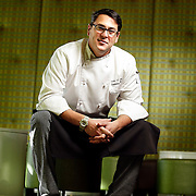 SHOT 11/20/09 12:01:48 PM - The Corner Office Executive Chef Carlos A. Ruiz at the restaurant and martini bar in downtown Denver, Co. Global comfort food is the menu's signature style, pairing international & traditional flavors for a fresh twist on your favorite dishes. (Photo by Marc Piscotty / © 2009)