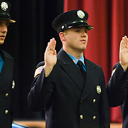 10/16/11 Wilmington DE:  Fire Academy Graduates taking the oath of office during Wilmington Fire Academy Graduation Ceremony Monday, Oct. 17, 2011 at P.S. Dupont Middle school in Wilmington Delaware.<br /> <br /> Funding for 13 of the 14 members of the current class is coming from a controversial grant approved by City Council this past spring.<br /> <br /> The 13 men and one woman make up the 36th Wilmington Fire Department Academy, which will bring the department up to 173 members.<br /> <br /> The News Journal/SAQUAN STIMPSON