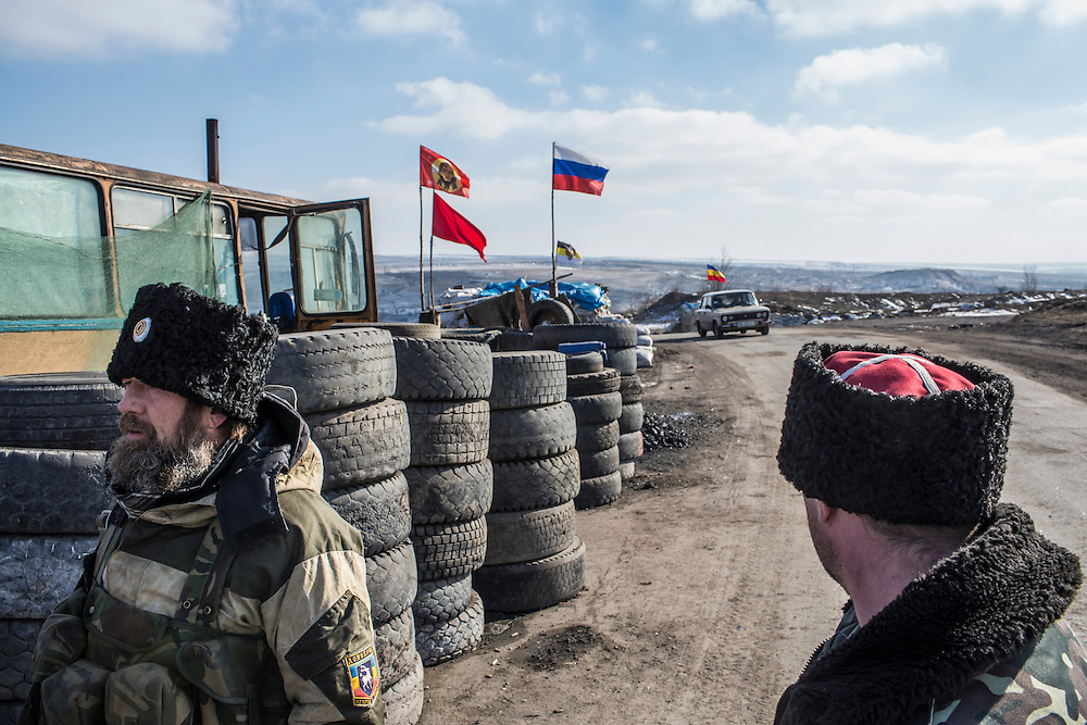 PEREVALSK, UKRAINE - FEBRUARY 20: Cossack rebels guard a checkpoint on February 20, 2015 in Perevalsk, Ukraine. Ukrainian forces withdrew from the nearby strategic and hard-fought town of Debaltseve after being effectively surrounded by pro-Russian rebels, though fighting has caused widespread destruction in the town. (Photo by Brendan Hoffman/Getty Images) *** Local Caption ***