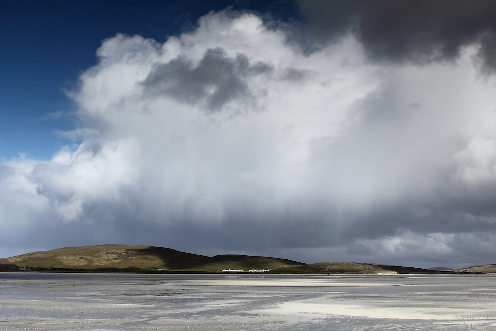 Clouds hang over the beach that serves as Barra Airport, on Barra, a small island at the southern end of the Outer Hebrides, Scotland