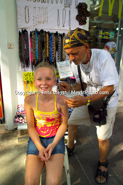 Bodrum, Turkey, July 2004.  A girl gets her hair braided.  Photo by Frits Meyst/Adventure4ever.com