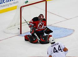 Nov 9, 2008; Newark, NJ, USA; Edmonton Oilers defenseman Sheldon Souray (44) scores a goal against New Jersey Devils goalie Scott Clemmensen (35) during the second period at the Prudential Center.