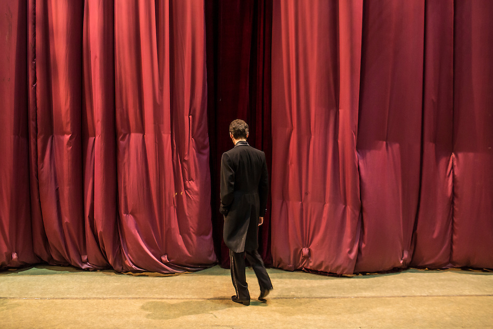 DONETSK, UKRAINE - FEBRUARY 1, 2015: Vadim Volovchuk, a performer with the Donetsk National Academic Opera and Ballet Theatre, practices dance moves behind a closed curtain before a performance in Donetsk, Ukraine. The opera company kicked off a new season in October, despite a separatist insurgency in Eastern Ukraine that has killed more than 5000 people. CREDIT: Brendan Hoffman for The New York Times