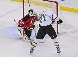 Oct 8; Newark, NJ, USA; Dallas Stars left wing Loui Eriksson (21) scores the game winning goal past New Jersey Devils goaltender Martin Brodeur (30) during overtime at the Prudential Center. The Stars defeated the Devils 4-3.