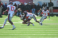 Arkansas safety Ross Rasner (35) is tackled by Ole Miss wide receiver Donte Moncrief (12) following an interception at War Memorial Stadium in Little Rock, Ark. on Saturday, October 27, 2012. Ole Miss won 30-27...