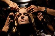 Make-up on a model before designer Akira Naka's fashion show at hotel CLASKA. Tokyo 28 March 2009