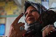 An Egyptian woman shows off her finger that has been dipped in blue ink marking that she has cast her ballot  at a polling station in the  Zeinab Zeina neighborhood of  Cairo , Egypt May 23, 2012. Egyptians head to the polling stations throughout Egypt  Wednesday for an historic opportunity in which they will for the first time to pick their president in a wide open election that pits Islamists against men who served under deposed leader Hosni Mubarak.(Photo by Heidi Levine/Sipa Press).