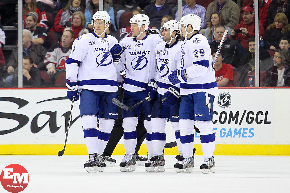 Feb 7, 2013; Newark, NJ, USA; The Tampa Bay Lightning celebrate a goal by Tampa Bay Lightning center Nate Thompson (44) during the second period at the Prudential Center.